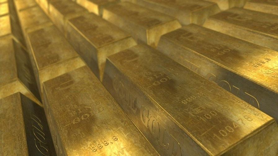 poukładane sztabki złota